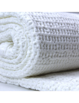 White honeycomb design blanket pictured rolled up on on white background
