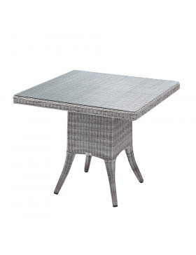 Four seater grey rattan garden table at an angle with white background
