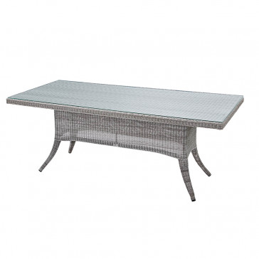 Eight seater grey rattan garden table at an angle on white background