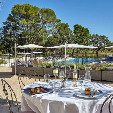 Bistro dining set table and chairs on terrace infront of pool