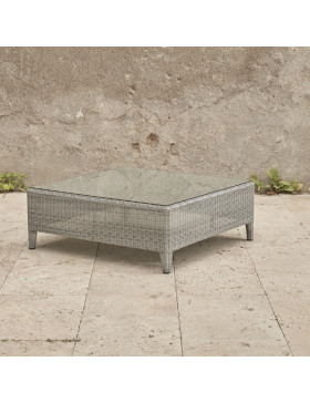 Oceane garden coffee table with tempered glass top French grey rattan pictured on Southern French terrace.