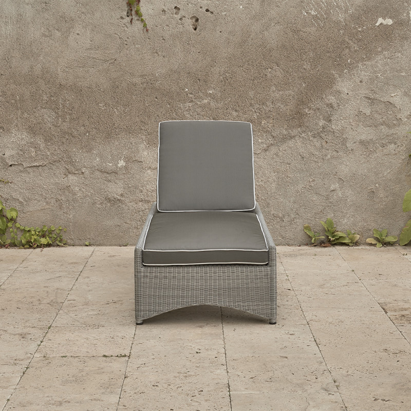 Rattan sun lounger with French grey UV resistant cushions on a southern French terrace