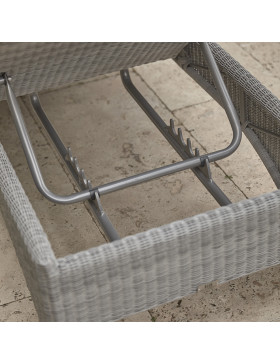 Back of rattan sun lounger showing how to adjust seat height
