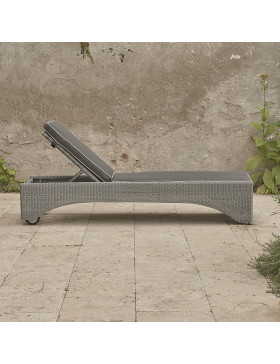Rattan sun lounger with French grey UV resistant cushions  side view on a southern French terrace