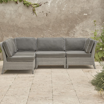 Oceane modular set showing three corners and two middle seats French grey rattan on Southern French terrace.