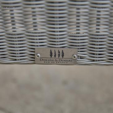 Close up of Domaine & Demeure logo on rattan garden furniture