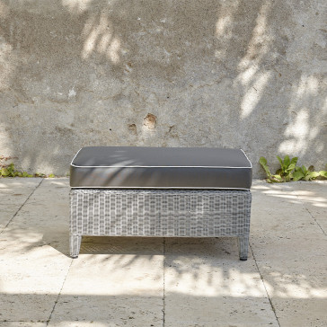 Oceane garden foot stool French grey rattan pictured on Southern French terrace.