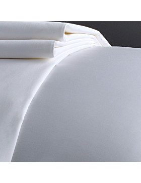 White folded flat sheet on a bed