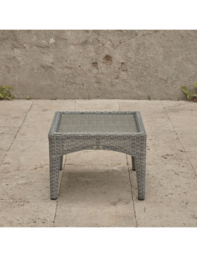 Side table with tempered glass top on a french terrace