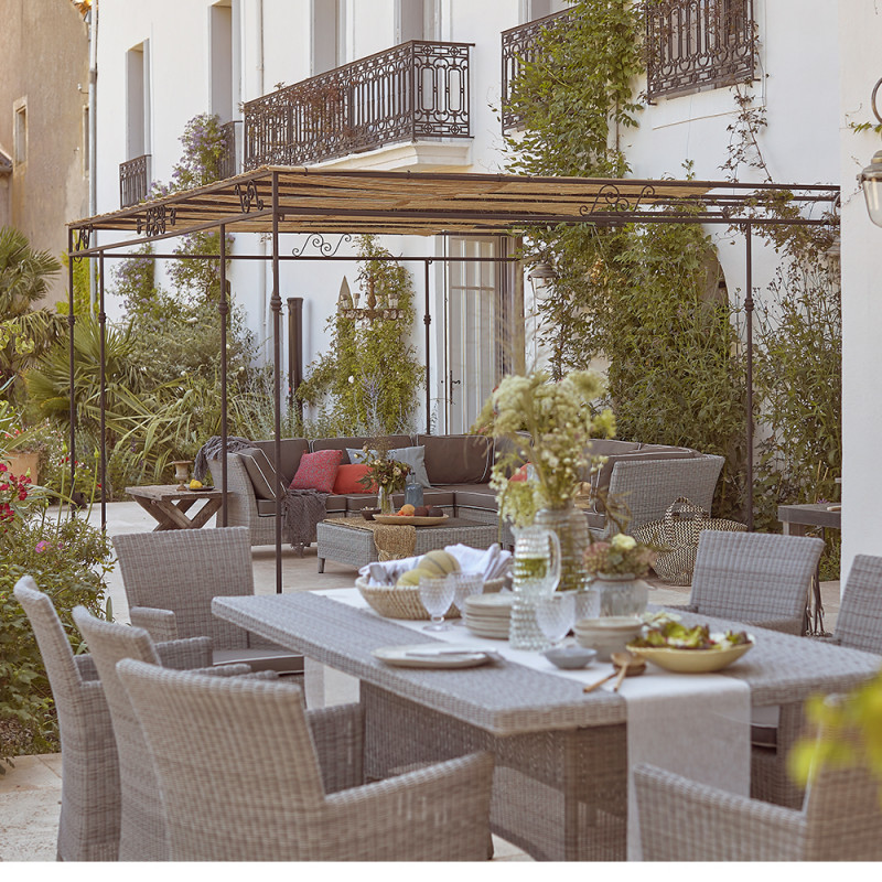 8 seater table and chairs. French Grey rattan. Corner lounge set on a French terrace.
