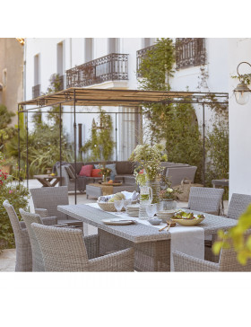 Eight seater table and chairs. French Grey rattan. On a French terrace beside corner lounge set