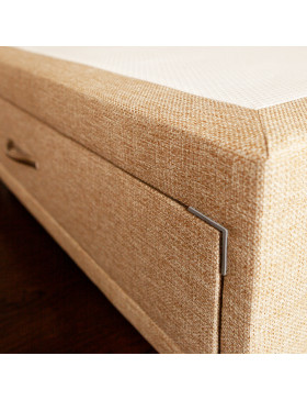 Close up image of Divan bed base with drawer upholstered in an oatmeal furniture fabric pictured on a wooden floor